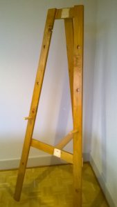 Rustic Pine Easel showing the peg system for holding the display work.